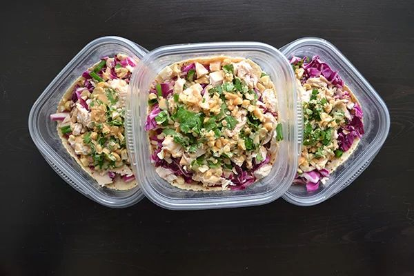 M/W/F: Asian Chicken Wrap (3 oz. rotisserie chicken breast; 8 raw, unsalted cashews; one 6-inch whole wheat tortilla; 1 cup shredded cabbage, cilantro or parsley; green onion; Peanut Lime Dressing [¼ cup smooth peanut butter, 2 Tbsp. fresh lime juice, 1 Tbsp. rice vinegar, 2 tsp. finely chopped fresh ginger, 2 tsp. reduced-sodium soy sauce, 2 tsp. raw honey] = 1 Green, 1 Yellow, 1 Red, 1 Blue, 2 tsp.)