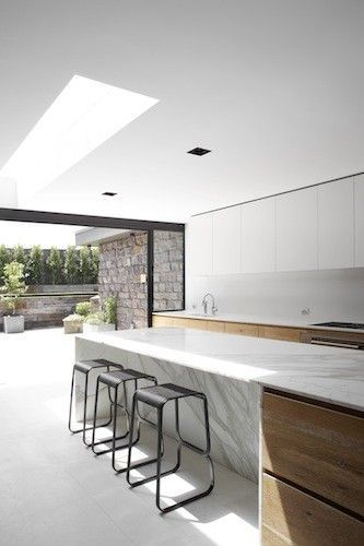 Daylight entering the kitchen inside the Dale House by Robson Rak Architects.