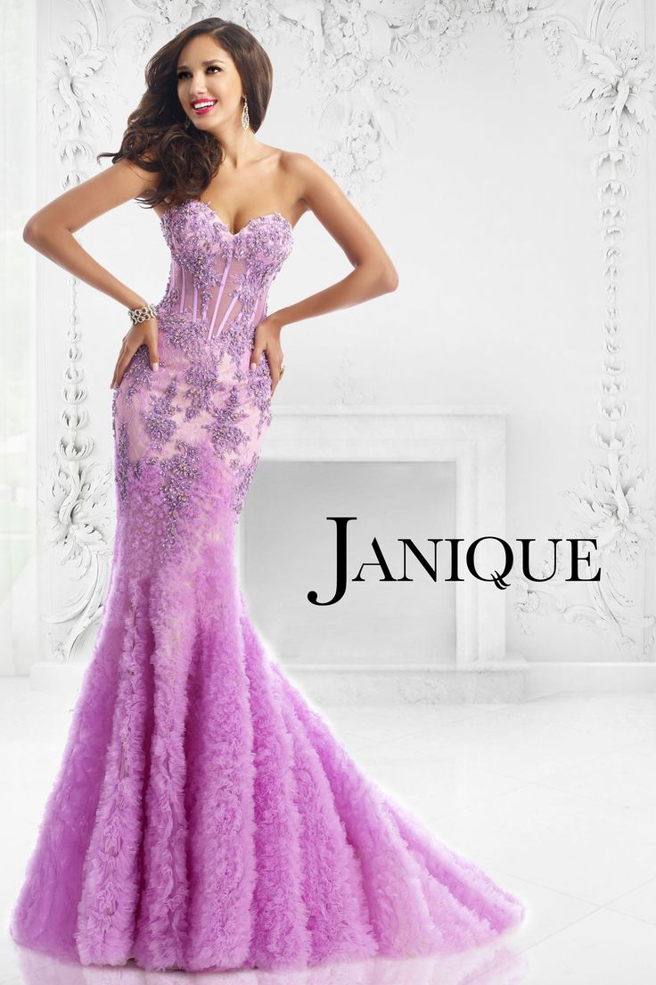 Janique 1515 2015 Collection. Be the ultimate glamour girl in Janique 1515. This luxurious evening gown features a strapless neckline. An applique of floral beaded embellishments sculpt the prominent sweetheart bodice. Sheer midriff is created to easily flaunt your curves. A soft floral applique forms the mermaid skirt that holds a voluminous look. #Janique2015 #Beaded #Strapless #Curves #Laced #Flare #Violet