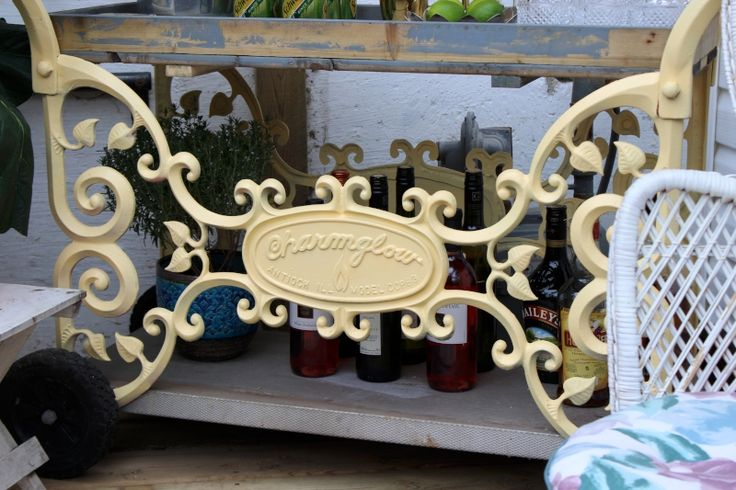 Vintage bbq turned into an outdoor bar cart