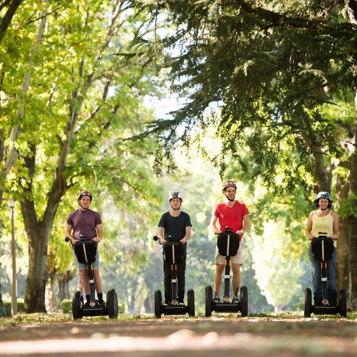 Segway riders cruise under the trees on the lawns of Old Parliament House in Canberra. #visitcanberra