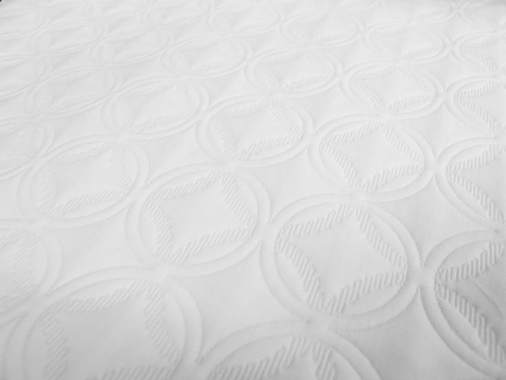 Paradise White, Winner Best Hospitality Textile, Interior Design Best of Year Awards 2013, part of the Touché Matelassé Collection from  #FabricInnovations #hospitality #bedding #design #BestHospitalityTextile #2013