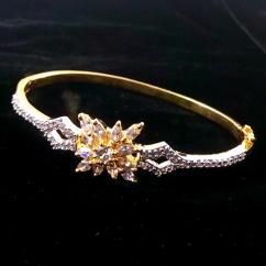 FLOWER CZ AMERICAN DIAMOND GOLD PLATED BRACELET BANGLE ₹750.00 INR Buy at http://crazyberry.in/online-shopping/artificial-imitation-fashion-jewellery/flower-cz-american-diamond-gold-plated-bracelet-bangle