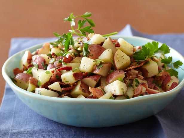 Bobby Flay's Top Recipes  German Potato Salad:  The tip for a great potato salad is to cut up and dress the potatoes while they are still warm, so the dressing soaks into them.  And the warm bacon dressing is a crowd-pleaser.
