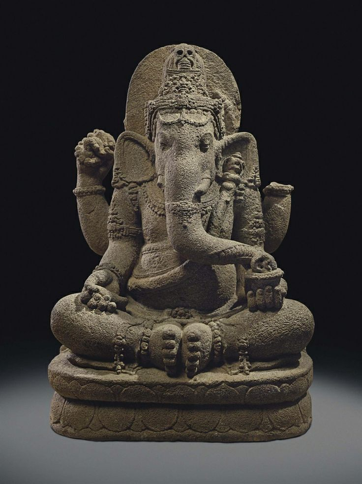A volcanic stone figure of Ganesha. Indonesia, Central Java, circa 9th century