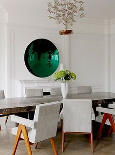 WHITE DINING ROOM |  fabulous apartment  in  Cadogan Square, London, designed by Joseph Dirand. modern dining toom all white, with a marble dining table, and green round mirro | www.bocadolobo.com #diningroomdecorideas #moderndiningrooms