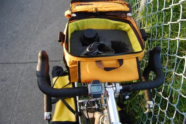 My Arkel Big Handlebar bag. I used pop-out foam to customize the insides for my Nikon D40 and lenses. The foam is three layers t