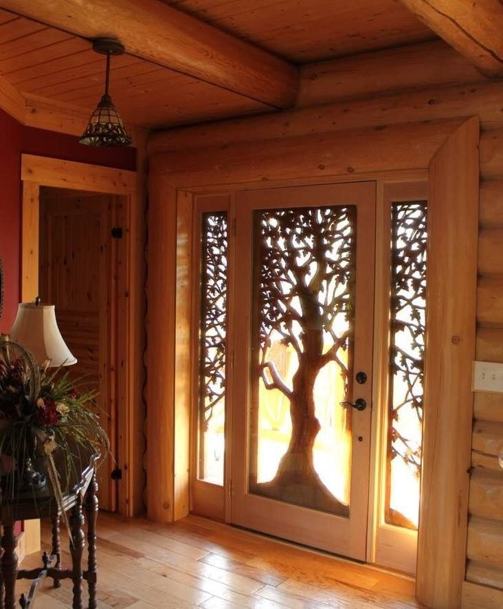 Incredible wood carving to create this entrance door and side panels.