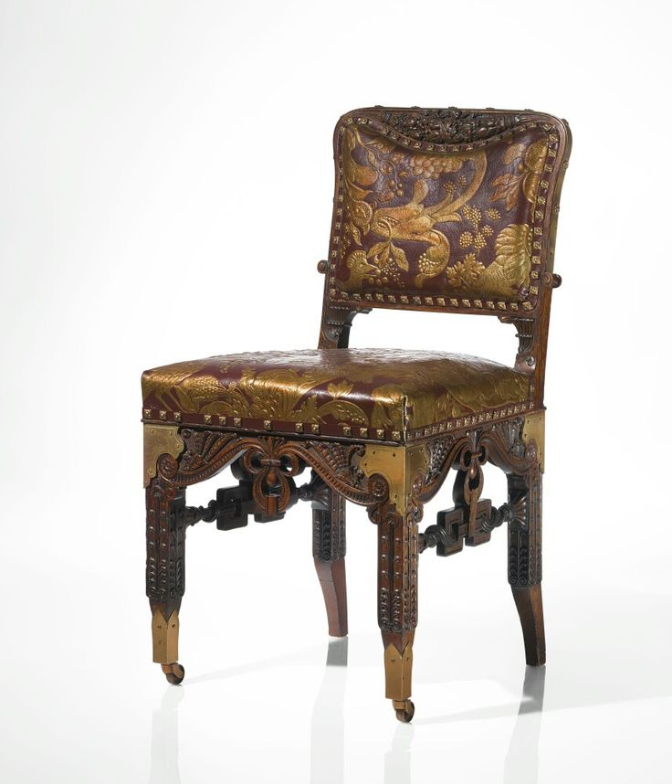 Herter Brothers AN IMPORTANT SIDE CHAIR FROM THE DINING ROOM OF THE WILLIAM H. VANDERBILT HOUSE, NEW YORK stamped 137 carved oak, brass and parcel-gilt and embossed leather upholstery 34 3/4  x 17 1/2  x 18 1/2  in. (88.3 x 44.5 x 47 cm) circa 1881-1882.