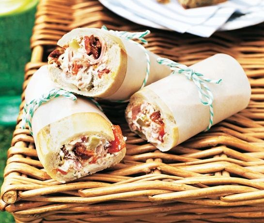 Baguettes filled with goats' cheese, smoked ham, pickled cucumber, red peppers and sun-dried tomatoes