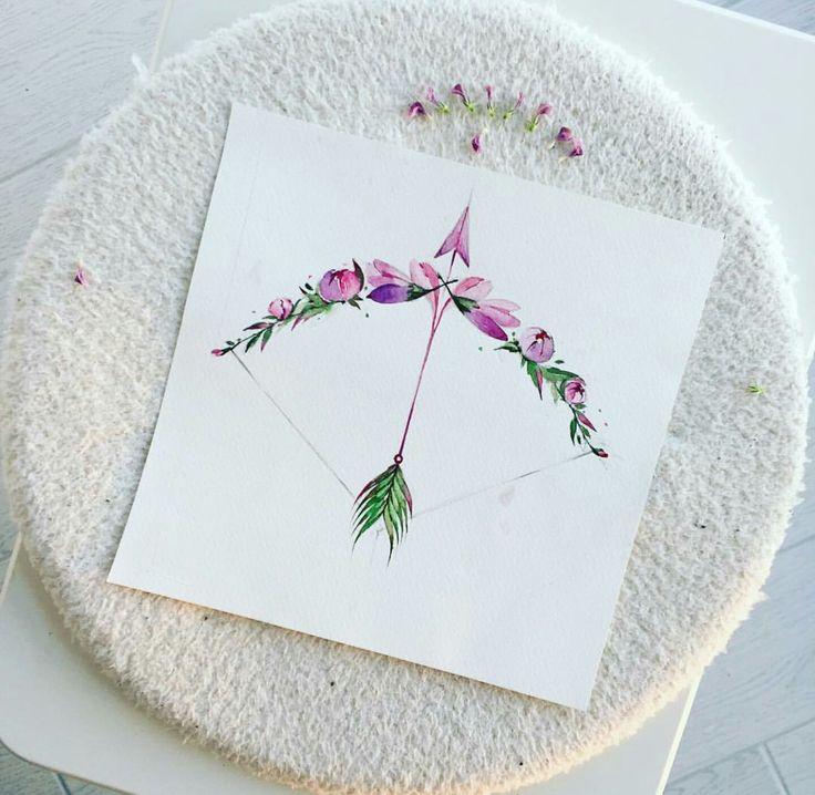 Arrow and bow floral tattoo idea