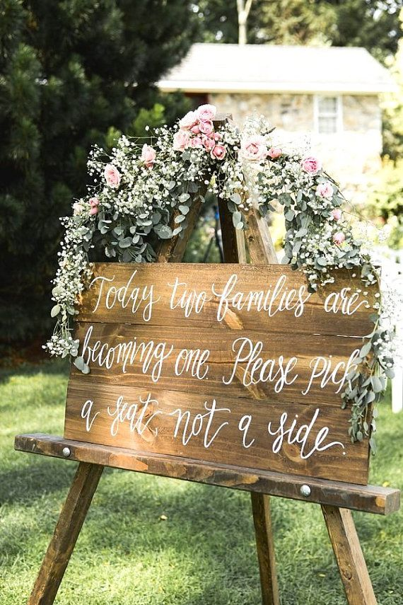 Custom hand painted Pick a Seat Not a Side sign. Perfect for your ceremony decor!   Dimensions: 30x16.5 Comes attached together to be displayed leaning or on an easel. (Easel not included)   Lead Time: BEFORE ordering, please click the Shipping & Policies tab above to view our lead time. If you plan on ordering more than one item, please email us for a custom invoice. We like to ensure you never pay too much in shipping! For lead time details, shipping info and FAQs, please view our…