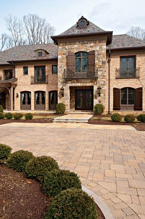 Image stone and brick exterior french country home 2011 for French country brick exterior