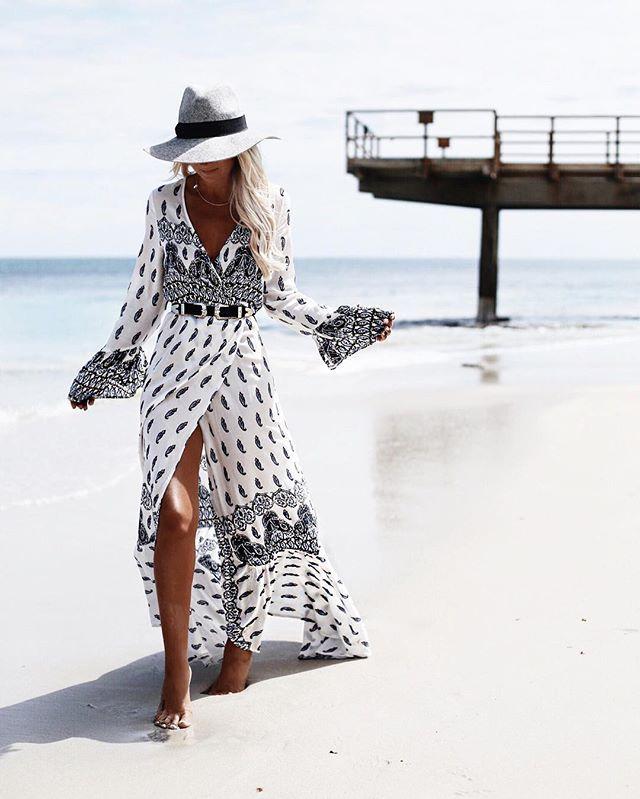 Beautiful breezy beach walk in between the storm clouds ☁️wearing new @lesalty_label wrap dress  @bobbybense #lesaltylabel