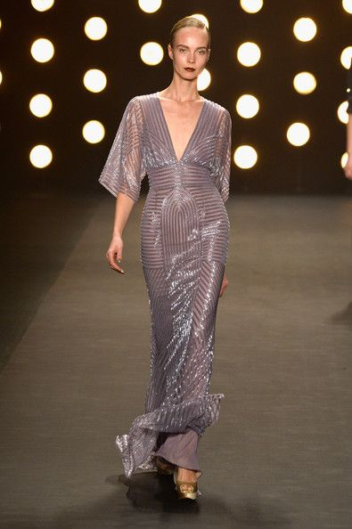 A model walks the runway at the Naeem Khan fashion show during Mercedes-Benz Fashion Week Fall 2014 at Lincoln Center on February 11, 2014 i...
