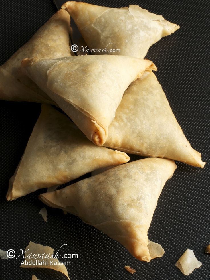 Somali beef samosas + spring roll wrappers. Great dough idea! I'd love to try it with a veggie filling.