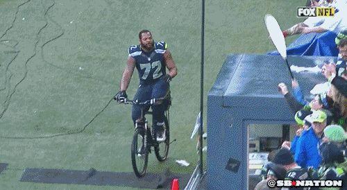 Seattle Seahawks DE borrows police bike for victory ride