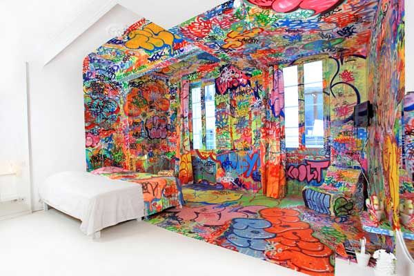 Slashing a hotel room in two has never looked so interesting! This half white, half graffiti-covered interior can be admired at the Au Vieux Panier hotel in Marseille, France. Each of the five rooms of the hotel are annually redesigned by artists, graphic designers, and painters from all over, each of them lending a unique style to the interiors.