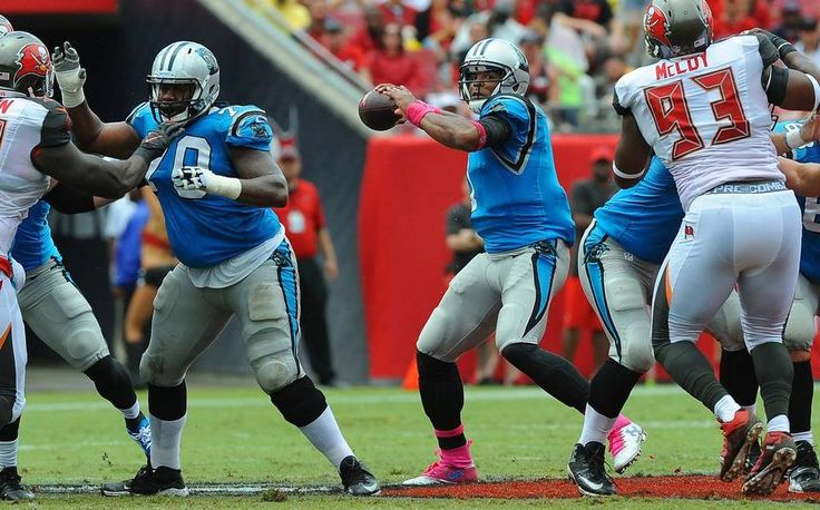Carolina Panthers quarterback Cam Newton, center, drops back to pass during first quarter action vs the Tampa Bay Buccaneers on Sunday, October 4, 2015 at Raymond James Stadium in Tampa, Fl. The Panthers defeated the Buccaneers 37-23.