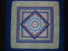 """At the 2005 AQS Paducah show there wasn't a 'Best Miniature Quilt' award. This award began in 2006. The 'First place' in the 'Miniature Quilts' category was won by """"LONE STAR"""" - made by Sally Collins, Walnut Creek, CA, USA."""