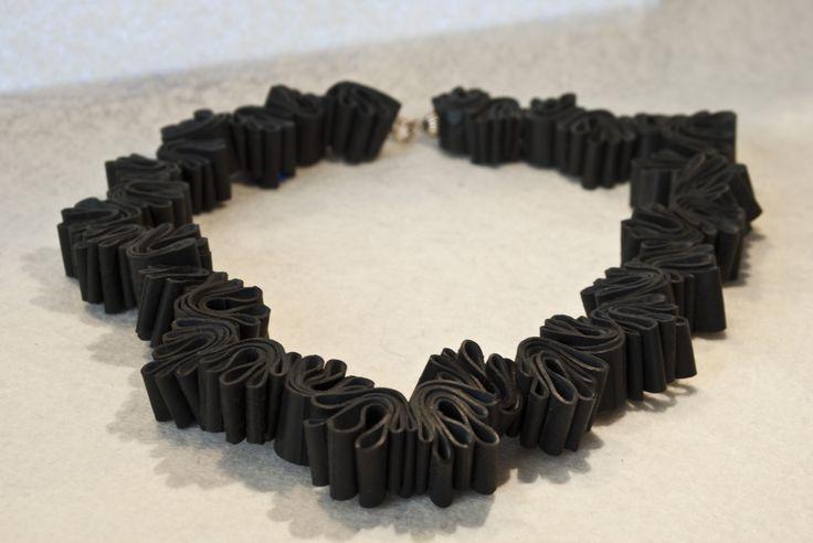 Inner tube necklace/ Loves me, loves me not