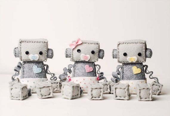 Baby Robots are super cute with a diaper and binky in pink, blue or yellow. A little baby robot would make the perfect baby shower gift for decor for