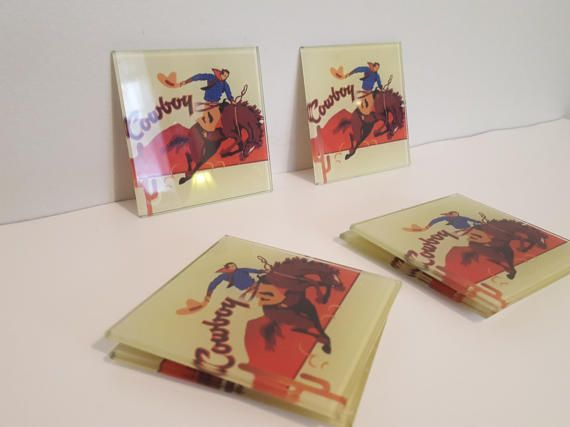 ON SALE, Cowboy Coasters, Vintage Coasters, Glass Coasters, Southwestern Decor, Cowboy Decor, Horse Coasters, Country Coasters, Country Life, Western Decor, Western Coasters, Western ware, Home and living, kitchen and dining, drink and barware.  Rare and awesome set of 6 glass coasters with an image of a Rodeo Cowboy, the coasters are in excellent condition.  A lot of our products our vintage which means that they are not in a brand new condition. All of our product are renewed and brought…