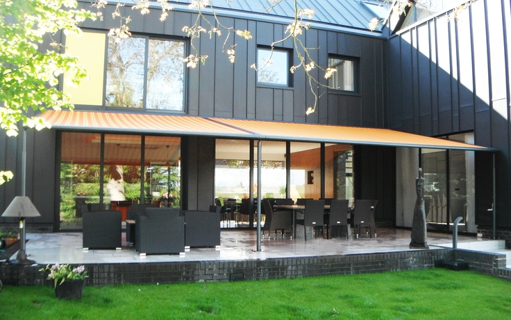 A luxury property in Hertfordshire installed a Markilux Pergola Awning from SWR.  The awning cassette in anthracite grey complemented the zinc cladded house.