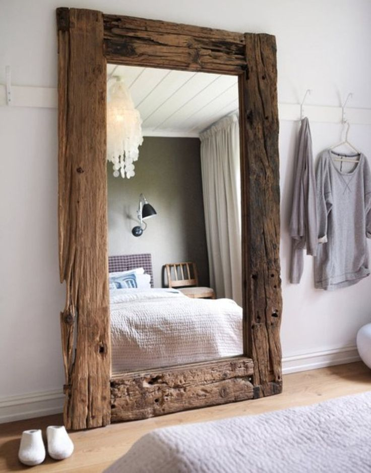 Reclaimed wood framed mirror...with the old mirrored closet door from Rose's room