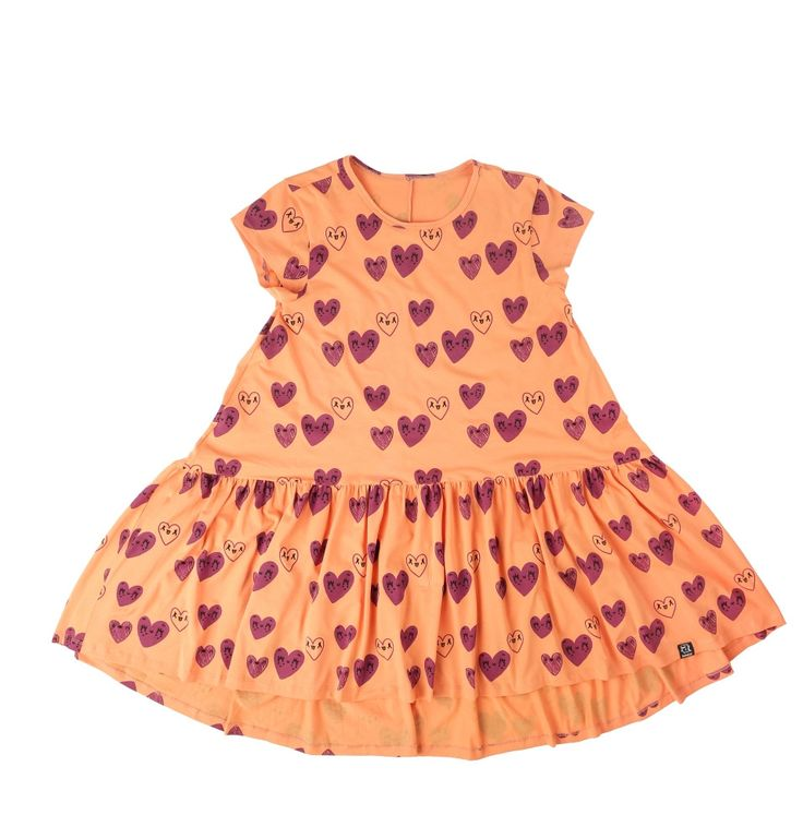 Orange dancing dress with red hearts, perfect for hours of twirling around in circles. Rebel but cute. By KuKuKid offered by Modern Rascals.