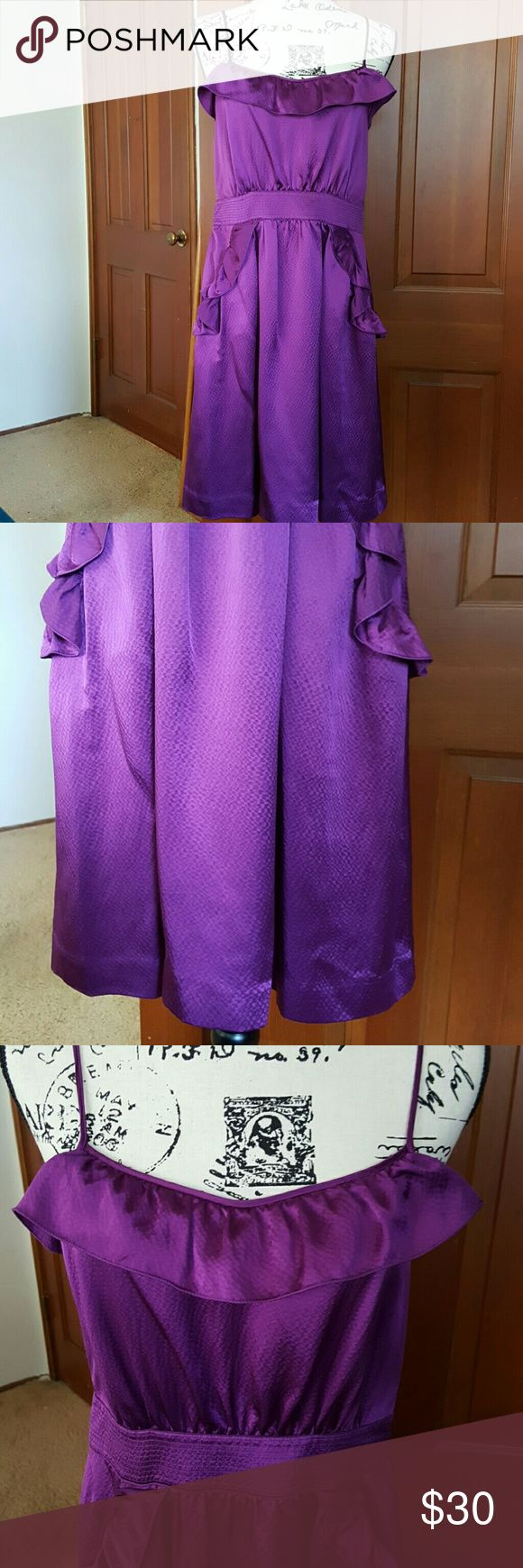 Marc By Marc Jacobs purple dress 100% silk size 6 Gorgeous purple a hundred percent silk Marc Jacobs purple dress , cute Pockets with little ruffles and a tie in the back the straps are in perfect condition so is the dress . Great dress for summer a party or going out with the girls .  Length from zipper 29 link from stripe 36 Marc Jacobs Dresses Midi