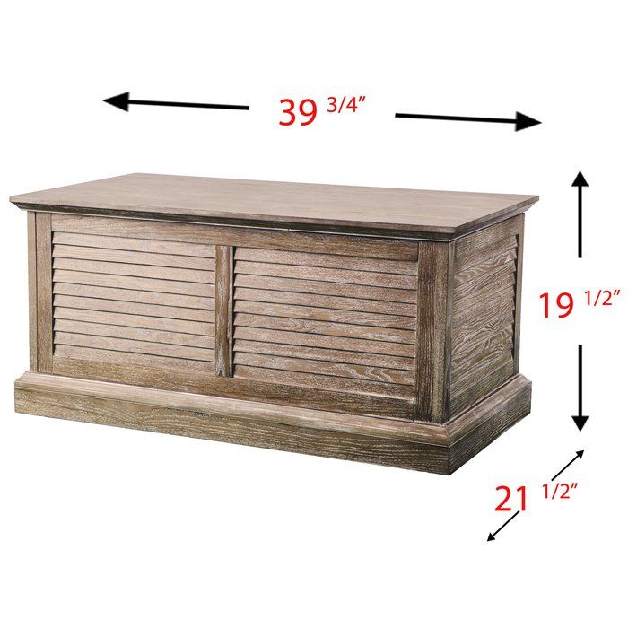 Place the keepsakes near without cluttering common spaces by installing this Thompson Louvered Coffee Table Trunk in your den or family room. Louvered details and a burnt oak hue hint at modern farmhouse charm. Lid lifts, revealing enclosed storage for photo albums, remotes. Shut the door on clutter with this product.