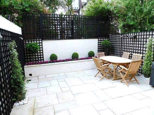 Mint sandstone patio paving installation london dining for Courtyard stone landscape