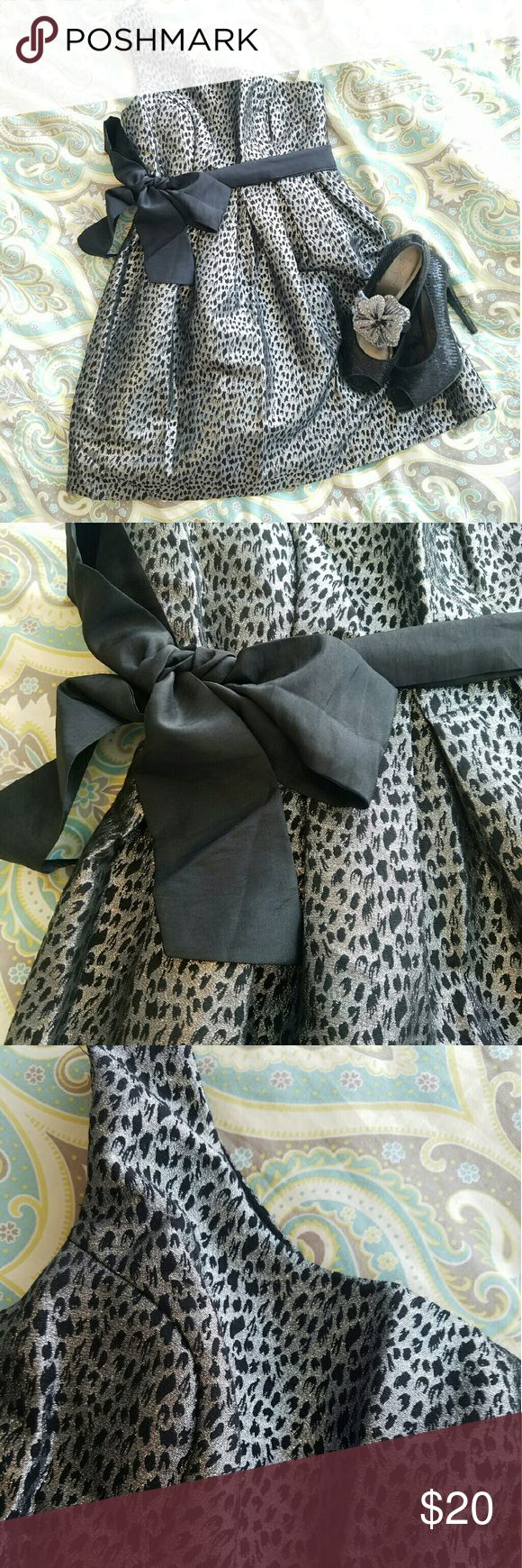 Forever 21 one shoulder poof skirt dress This fun silver with black animal print dress is great for homecoming, prom, or a new years eve party. Dress it up with so sparkly shoes. The bow can go on the side, front or back. However you want. Forever 21 Dresses Prom