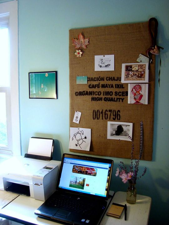 Coffee sack bulletin board? Or staple over some different sized canvases in the dining room.
