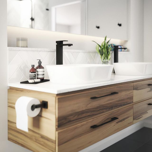 This absolutely amazing render concept image by Robert Dukes from @rdvisualisation features a sleek, floating timber vanity, finished with our matte black cabinet handles along with a stone, shadow line benchtop, above counter basins and our truly unique tall matte black basin mixers.