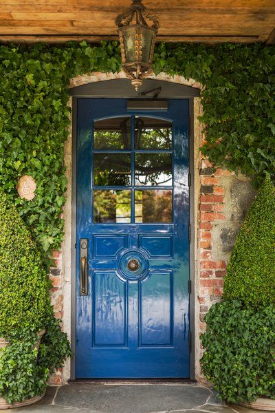 A Look Inside The French Laundry's Stunning $10M Renovation - Photo 11 of 11 - The French Laundry's iconic blue door.