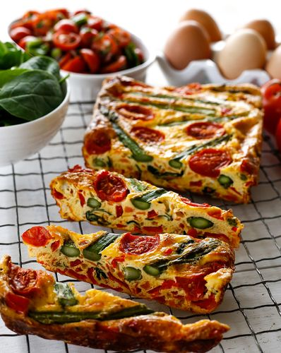 Frittatas are easy to make and brilliant to transport and delicious hot or cold, making them a great vegetarian breakfast or lunch option – and this asparagus and tomato frittata slice from The Foodie Teen cookbook is absolute heaven. Try mixing up the veggies to create different flavour combination