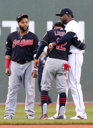 Boston Red Sox designated hitter David Ortiz (34) shares a moment with Cleveland Indians shortstop Francisco Lindor (12) and Cleveland Indians designated hitter Carlos Santana (41) before  the ALDS  playoff game #three between the Cleveland Indians and the Boston Red Sox played in Boston on Monday, Oct. 10, 2016. (Chuck Crow/The Plain Dealer)