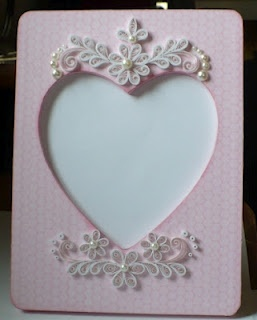 quilled paper and pearl frame embellishments Nice design - could also use velum for flowers and leaves