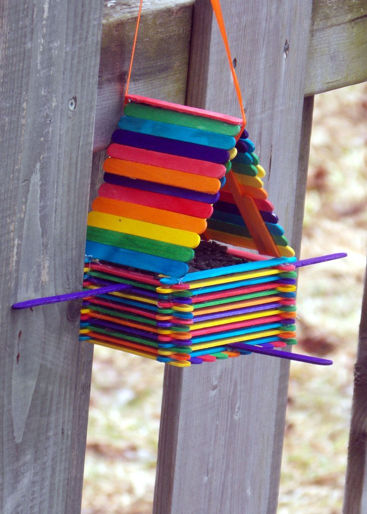 Popsicle Stick Bird House #2  Easy Birdhouse made out of colored craft sticks (Popsicle Sticks) hot glue, & ribbon cost about $2 to make