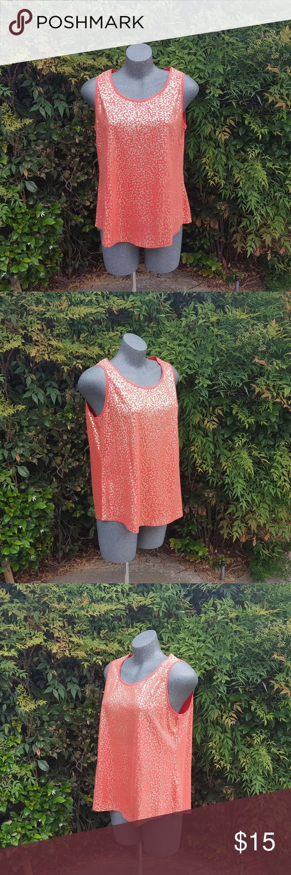 """Chico's Peach Orange Tank Top Size 2 / Large Cute tank top.  Metallic print.  Light stretch.  Fits loose. Color is a peachy orange color.   Not lined.  No stains or rips.  See kast photo for care instructions. Chicos sizing is different so a size 2 is really a size 12/14 or large. Please let me know if you have any questions.   Chest circumference: 41"""" Waist circumference: 42"""" Sweep circumference: 47.5"""" Length: 25.5"""" Strap width: 2.25"""" Strap width:  2.25"""" Sleeve opening: 20.25"""" Content: 60%…"""