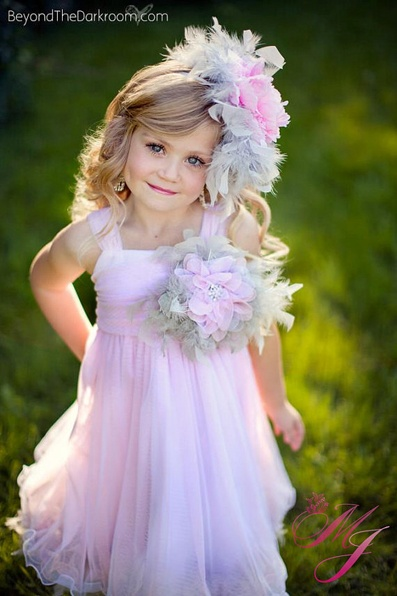 The Danielle style is PERFECT for photographers as well as flower girls. It's sizing is super versatile becuase of the lace-up back, plus it's incredibly swishy, twirly, and soooo soft!! Little girls will be as comfortable as they are gorgeous in this beautiful gown.