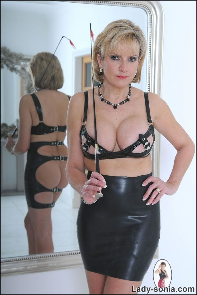 Sexy mistress in leather spanks the slut 3