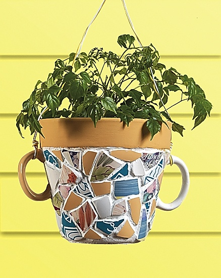 mosaic hanging planters made with broken coffee mugs, grout, clay pot and some wire.  Love this idea!