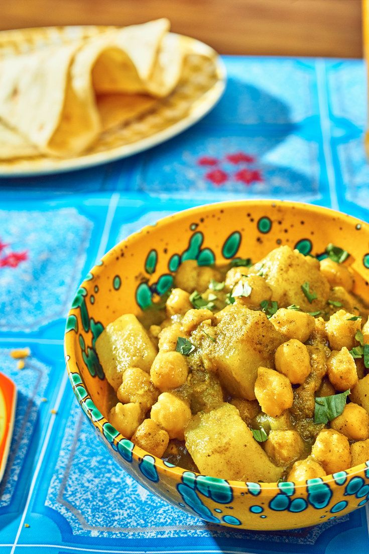 This savory, herbal Trinidadian chickpea-and-potato curry is an island…