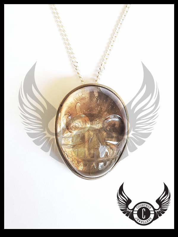 Hand carved skull gem pendant by Countess Jewellery