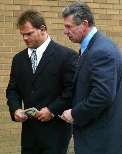 Vince McMahon consoling Chris Benoit at Stu Hart's funeral. : SquaredCircle