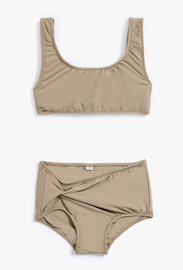 Shop the top swimsuit trends of Summer 2016 | Objects Without Meaning Twist Twist Two Piece, $125; at Need Supply Co.