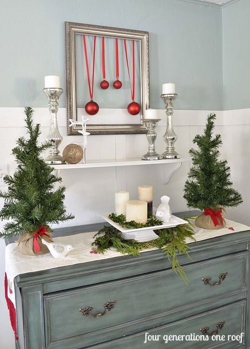 christmas vignette - replace candles with ornaments, garland behind
